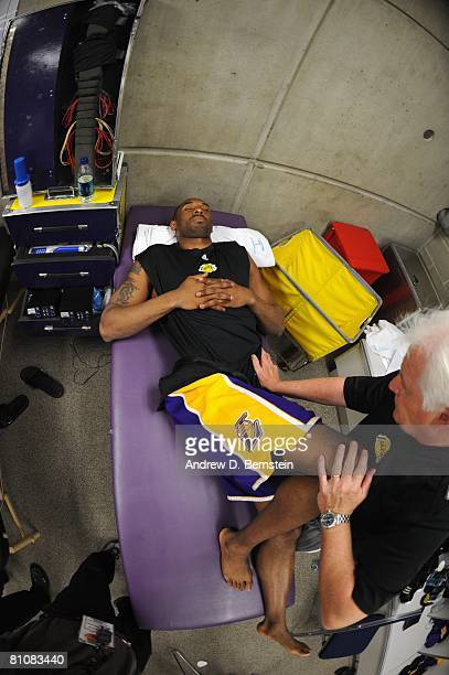 Kobe Bryant of the Los Angeles Lakers gets treatment in the training room before Game Three of the Western Conference Semifinals against the Utah...