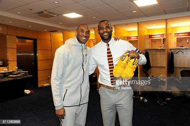 Kobe Bryant of the Los Angeles Lakers gifts a pair of sneakers for LeBron James of the Cleveland Cavaliers in the locker room after the game at The...