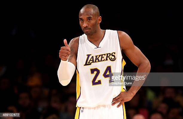 Kobe Bryant of the Los Angeles Lakers gives a thumbs up to a teammate in the game against the Golden State Warriors at Staples Center on November 16...