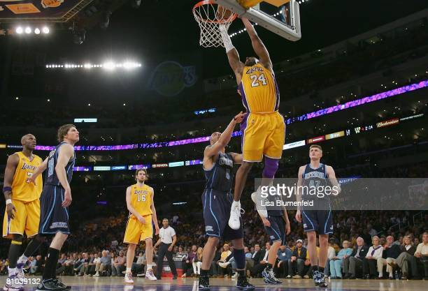 Kobe Bryant of the Los Angeles Lakers goes for a dunk against Carlos Boozer of the Utah Jazz in Game Two of the Western Conference Semifinals during...