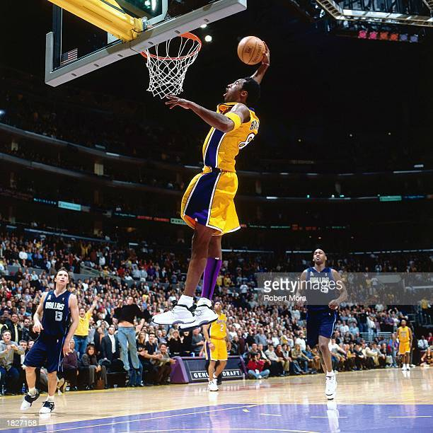 Kobe Bryant of the Los Angeles Lakers goes for a dunk against the Dallas Mavericks during the NBA game at the Staples Center on December 5 2001 in...