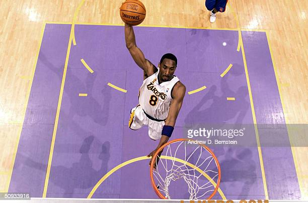 Kobe Bryant of the Los Angeles Lakers goes for a dunk against the Detroit Pistons during game one of the 2004 NBA Finals June 6 2004 at the Staples...