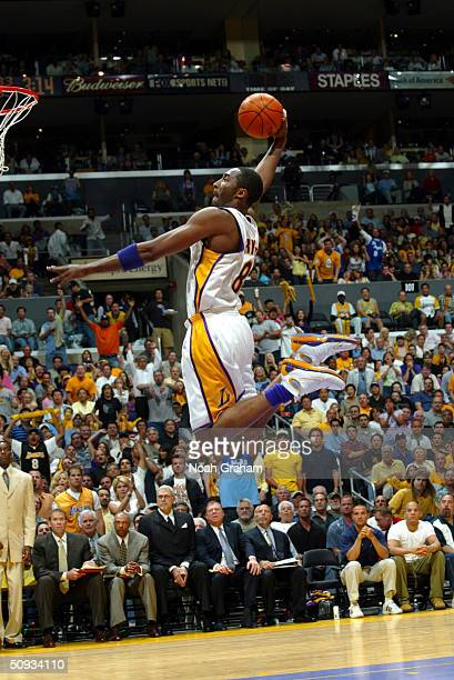 Kobe Bryant of the Los Angeles Lakers goes for a dunk against the Detroit Pistons during Game one of the 2004 NBA Finals at the Staples Center in Los...