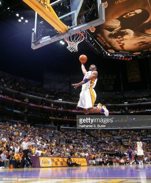 Kobe Bryant of the Los Angeles Lakers goes for a dunk during Game one of the 2004 NBA Finals against the Detroit Pistons at Staples Center on June 6...