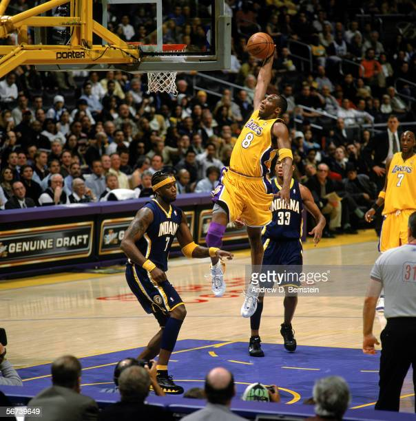 Kobe Bryant of the Los Angeles Lakers goes for a dunk over Jermaine O'Neal of the Indiana Pacers during the game at Staples Center on January 9 2006...