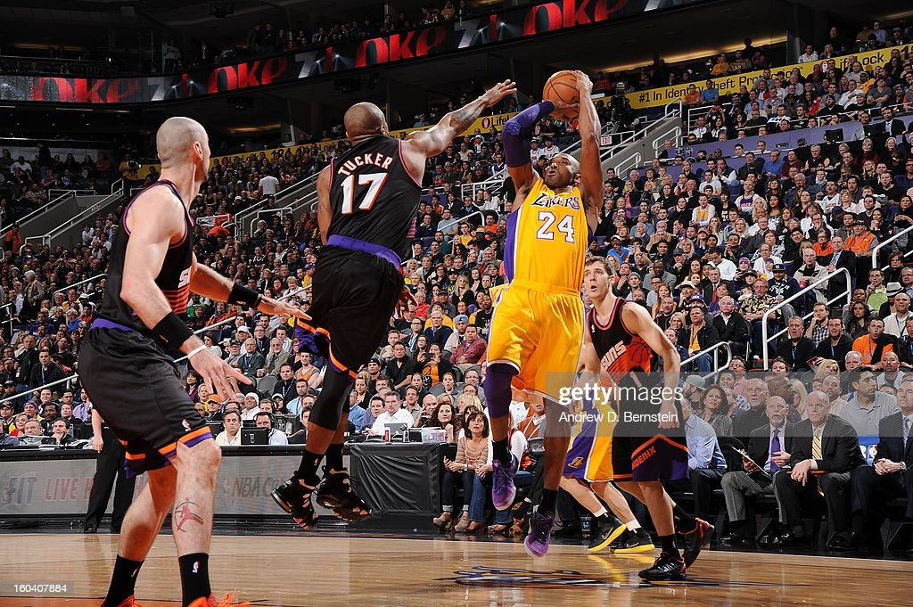 Kobe Bryant #24 of the Los Angeles Lakers goes for a jump shot against P.J. Tucker #17 of the Phoenix Suns during the game between the Los Angeles Lakers and the Phoenix Suns at US Airways Center on January 30, 2013 in Phoenix, Arizona.