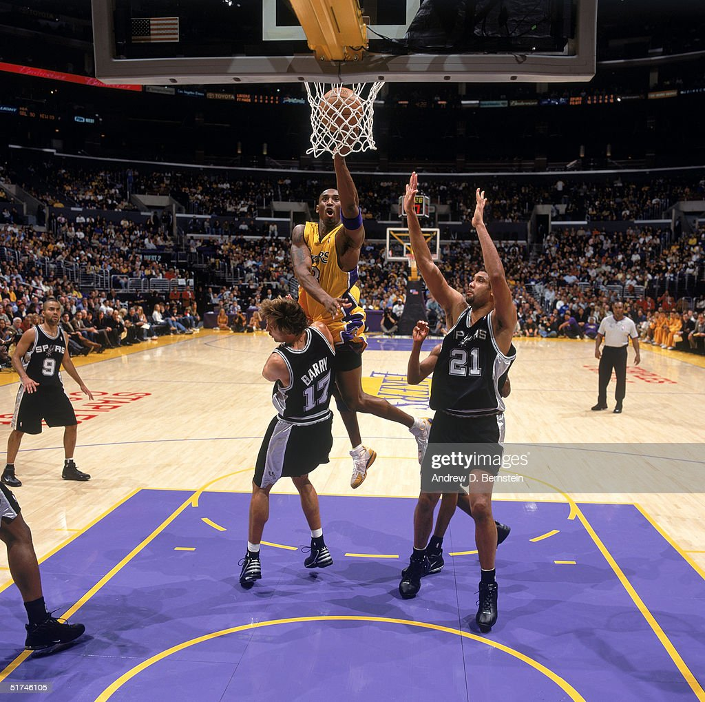 ac8f4434c Kobe Bryant of the Los Angeles Lakers goes for a layup against Brent ...