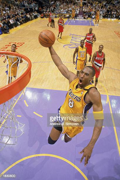Kobe Bryant of the Los Angeles Lakers goes for a slam dunk during the NBA game against the Portland Trail Blazers at Staples Center on February 21...