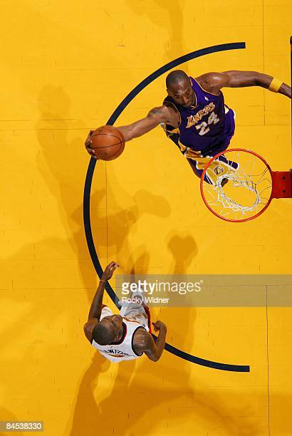 Kobe Bryant of the Los Angeles Lakers goes for the dunk against Jamal Crawford of the Golden State Warriors at Oracle Arena on January 7 2009 in...