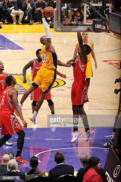 Kobe Bryant of the Los Angeles Lakers goes for the dunk during the game against the Houston Rockets on December 17 2015 at STAPLES Center in Los...