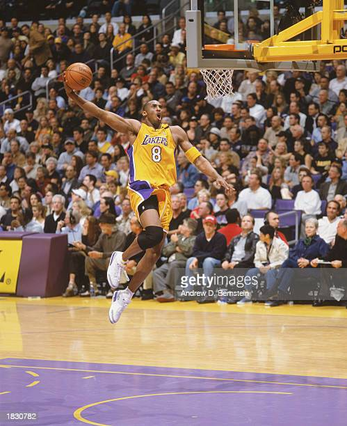 Kobe Bryant of the Los Angeles Lakers goes for the slam dunk during the NBA game against the Portland Trail Blazers at Staples Center on February 21...