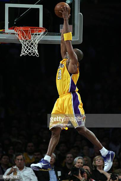Kobe Bryant of the Los Angeles Lakers goes in for a 2nd qtr dunk in the basketball game with the Los Angeles Lakers versus the Memphis Grizzlies at...