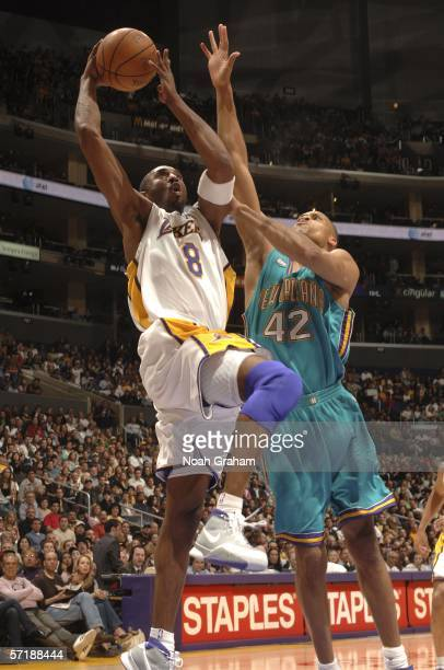 Kobe Bryant of the Los Angeles Lakers goes strong to the hoop against PJ Brown of the New Orlean/Oklahoma City Hornets on March 26 2006 at Staples...