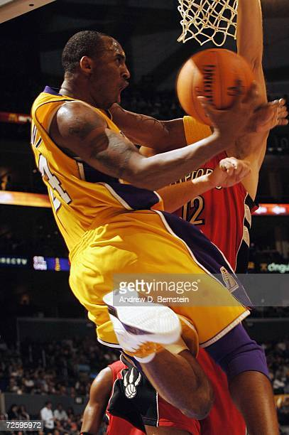 Kobe Bryant of the Los Angeles Lakers goes strong to the hoop against the Toronto Raptors on November 17 2006 at Staples Center in Los Angeles...