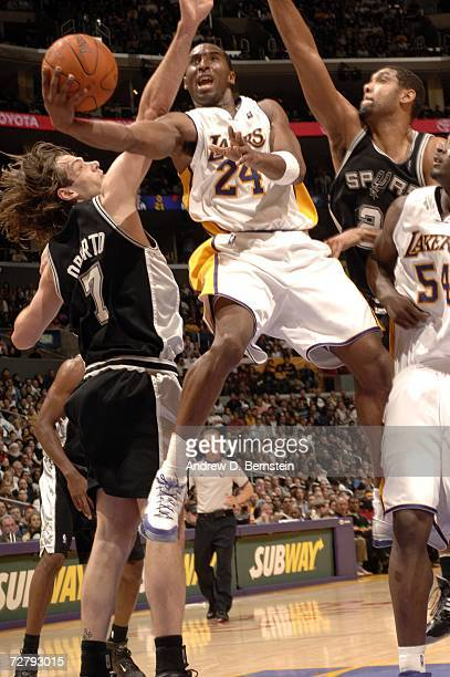 Kobe Bryant of the Los Angeles Lakers goes strong to the hoop against Tim Duncan and Fabricio Oberto of the San Antonio Spurs at Staples Center...
