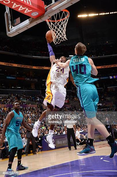Kobe Bryant of the Los Angeles Lakers goes to the basket against Cody Zeller of the Charlotte Hornets on November 9 2014 at Staples Center in Los...