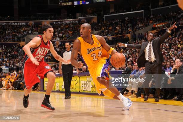 Kobe Bryant of the Los Angeles Lakers goes to the basket against Sasha Vujacic of the New Jersey Nets at Staples Center on January 14 2011 in Los...