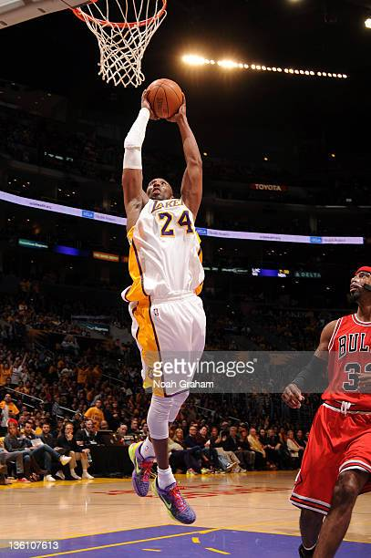 Kobe Bryant of the Los Angeles Lakers goes to the basket against Richard Hamilton of the Chicago Bulls at Staples Center on December 25 2011 in Los...