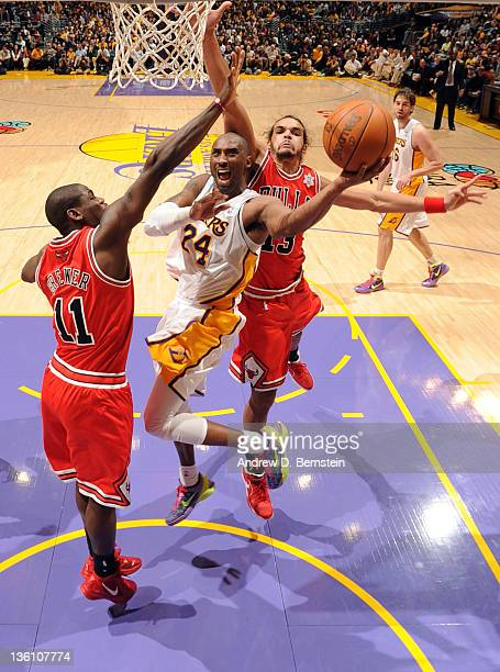 Kobe Bryant of the Los Angeles Lakers goes to the basket against Ronnie Brewer and Joakim Noah of the Chicago Bulls at Staples Center on December 25...