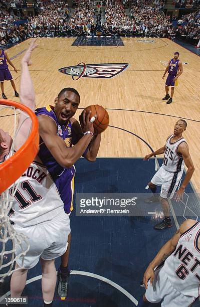 Kobe Bryant of the Los Angeles Lakers goes to the basket against Todd MacCulloch of the New Jersey Nets during Game four of the 2002 NBA Finals on...
