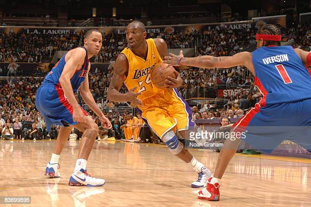 Kobe Bryant of the Los Angeles Lakers goes to the basket between Tayshaun Prince and Allen Iverson of the Detroit Pistons at Staples Center on...