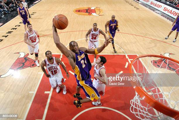 Kobe Bryant of the Los Angeles Lakers goes to the basket over John Salmons and Kirk Hinrich of the Chicago Bulls during the NBA game on March 21,...