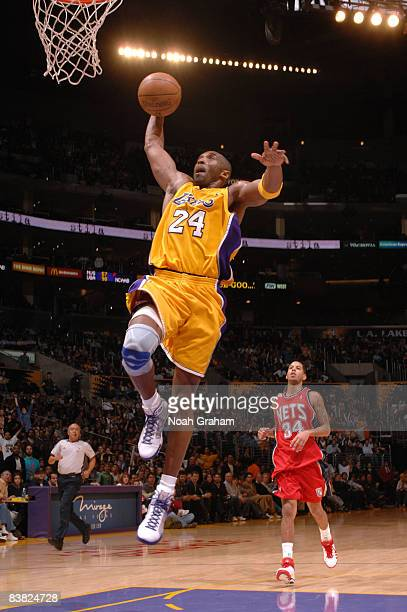 Kobe Bryant of the Los Angeles Lakers goes up for a breakaway dunk during the game against the New Jersey Nets at Staples Center on November 25, 2008...