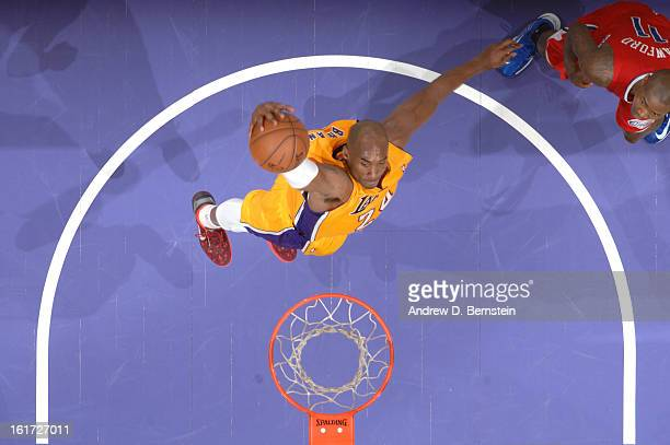 Kobe Bryant of the Los Angeles Lakers goes up for a dunk against Jamal Crawford of the Los Angeles Clippers at Staples Center on February 14 2013 in...