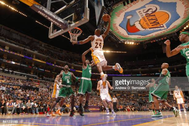 Kobe Bryant of the Los Angeles Lakers goes up for a dunk against Kendrick Perkins of the Boston Celtics at Staples Center on December 25 2008 in Los...
