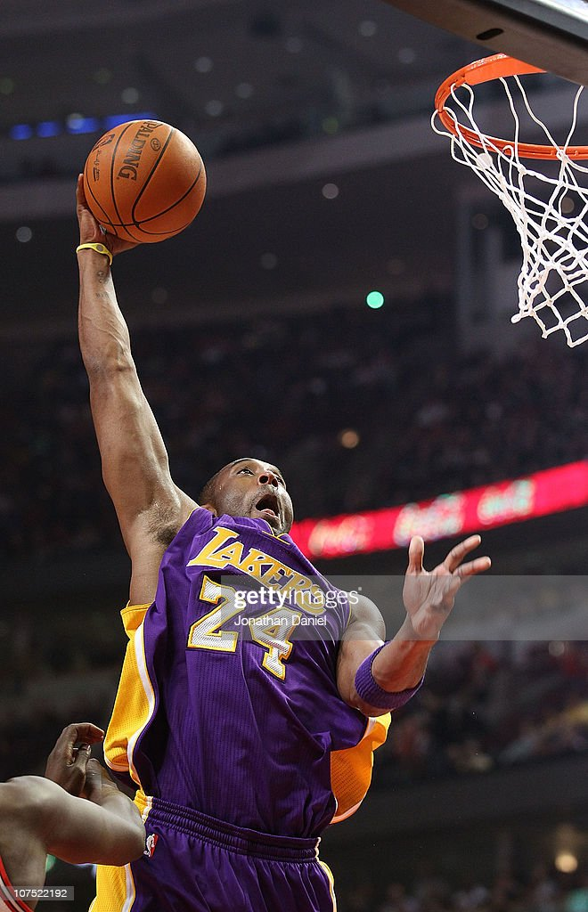 Kobe Bryant #24 of the Los Angeles Lakers goes up for a dunk against the Chicago Bulls at the United Center on December 10, 2010 in Chicago, Illinois.