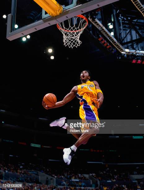 Kobe Bryant of the Los Angeles Lakers goes up for a dunk against the Golden State Warriors at the Staples Center on March 4, 2001. NOTE TO USER: User...
