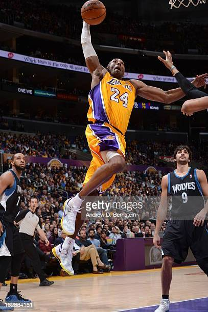 Kobe Bryant of the Los Angeles Lakers goes up for a dunk against the Minnesota Timberwolves at Staples Center on February 28 2013 in Los Angeles...