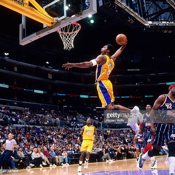 Kobe Bryant of the Los Angeles Lakers goes up for a dunk against the Houston Rockets at the Staples Center on February 27, 2000.NOTE TO USER: User...