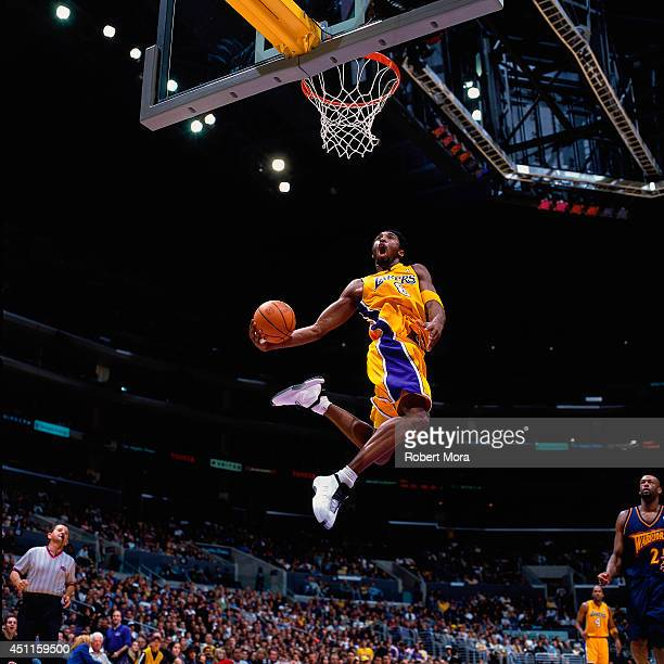 Kobe Bryant of the Los Angeles Lakers goes up for a dunk against the Golden State Warriors at the Staples Center on March 4 2001 NOTE TO USER User...
