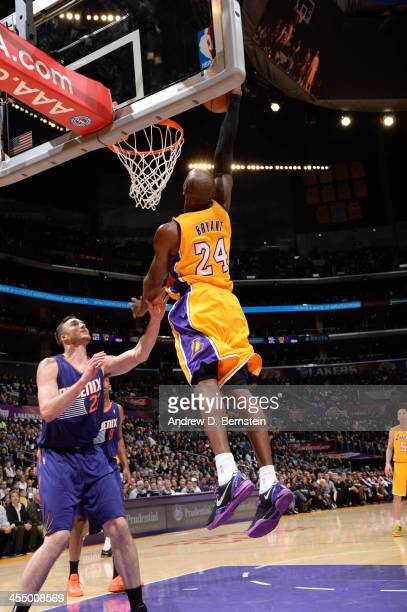 Kobe Bryant of the Los Angeles Lakers goes up for a dunk against the Phoenix Suns at Staples Center on December 10 2013 in Los Angeles California...