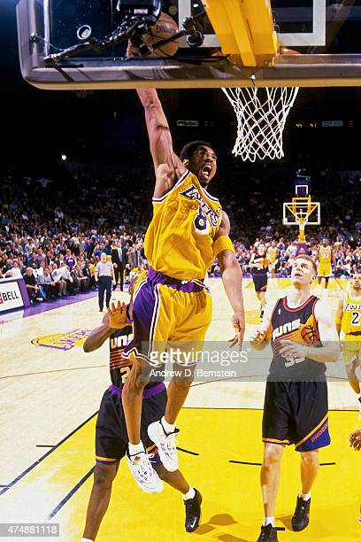 Kobe Bryant of the Los Angeles Lakers goes up for a dunk against the Phoenix Suns during a game in 1999 at Great Western Forum in Los Angeles...
