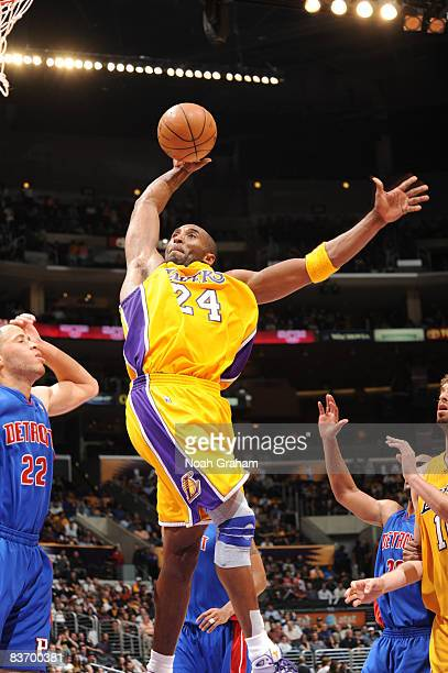Kobe Bryant of the Los Angeles Lakers goes up for a dunk against the Detroit Pistons at Staples Center on November 14 2008 in Los Angeles California...