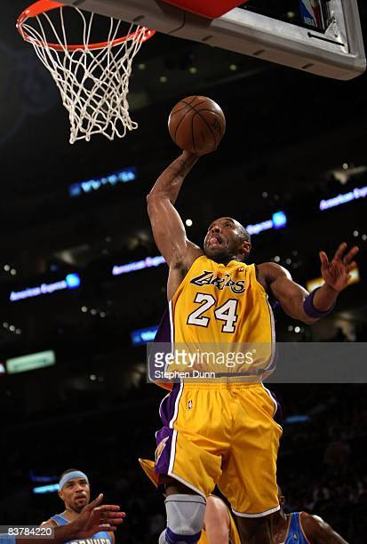Kobe Bryant of the Los Angeles Lakers goes up for a dunk against the Denver Nuggets on November 21, 2008 at Staples Center in Los Angeles,...