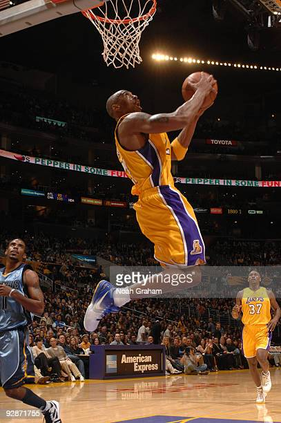 Kobe Bryant of the Los Angeles Lakers goes up for a dunk against the Memphis Grizzlies at Staples Center on November 6 2009 in Los Angeles California...