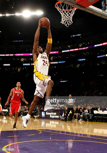 Kobe Bryant of the Los Angeles Lakers goes up for a dunk against the Houston Rockets on November 15 2009 at Staples Center in Los Angeles California...