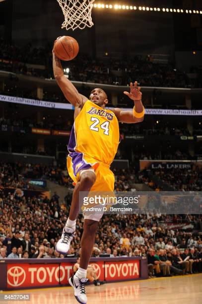 Kobe Bryant of the Los Angeles Lakers goes up for a dunk during a game against the Charlotte Bobcats at Staples Center on January 27 2009 in Los...