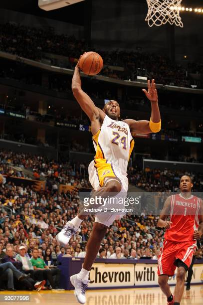 Kobe Bryant of the Los Angeles Lakers goes up for a dunk during a game against the Houston Rockets at Staples Center on November 15 2009 in Los...