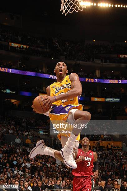 Kobe Bryant of the Los Angeles Lakers goes up for a dunk during the game against the Miami Heat at Staples Center on February 28 2008 in Los Angeles...