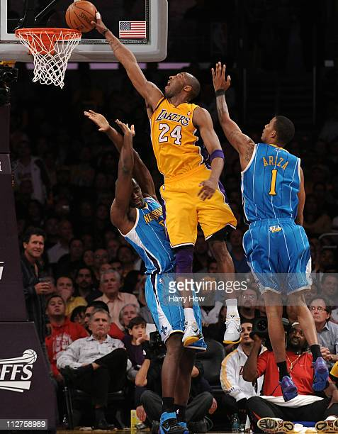 Kobe Bryant of the Los Angeles Lakers goes up for a dunk over Emeka Okafor of the New Orleans Hornets in Game Two of the Western Conference...
