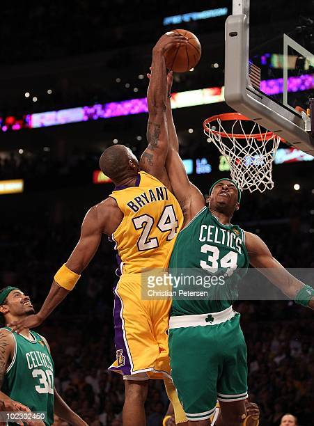 Kobe Bryant of the Los Angeles Lakers goes up for a dunk over Paul Pierce of the Boston Celtics in Game Seven of the 2010 NBA Finals at Staples...