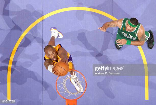 Kobe Bryant of the Los Angeles Lakers goes up for a dunk while Eddie House of the Boston Celtics looks on in Game Four of the 2008 NBA Finals at...