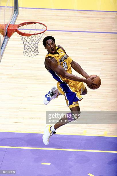 Kobe Bryant of the Los Angeles Lakers goes up for a reverse slam dunk during a game at The Staples Center in Los Angeles, California in, 2000. NOTE...