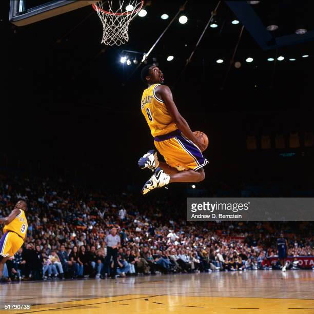Kobe Bryant of the Los Angeles Lakers goes up for a reverse slam dunk against the Minnesota Timberwolves during an NBA game at the Staples Center...