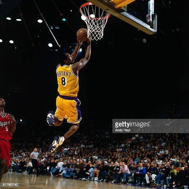 Kobe Bryant of the Los Angeles Lakers goes up for a reverse slam dunk against the Los Angeles Clippers during an NBA game at the Staples Center in...