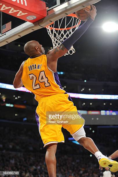 Kobe Bryant of the Los Angeles Lakers goes up for a reversedunk against the Washington Wizards at Staples Center on March 22 2013 in Los Angeles...
